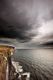 Storm clouds over ocean cliffs. Scenic view of black storm clouds over Kilt Rock cliffs on the Isle of Skye, Scotland Royalty Free Stock Photography