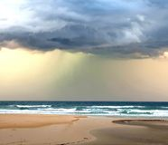 Storm clouds over the ocean Coolum Beach. Storm clouds over the ocean at Coolum Beach royalty free stock photography