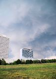 Storm clouds over office buildings Royalty Free Stock Image