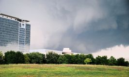 Storm clouds over office buildings Royalty Free Stock Images