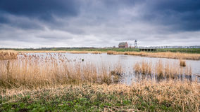 Storm clouds over the old port of schokland, Netherlands Stock Photography