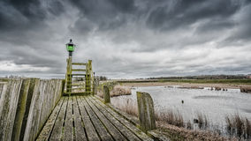 Storm clouds over the old port of schokland, Netherlands Royalty Free Stock Image