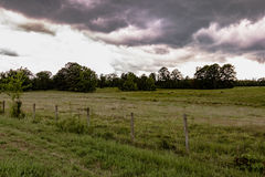 Storm clouds over a pasture Stock Image