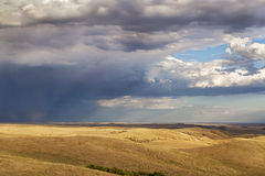 Storm clouds over a prairie Royalty Free Stock Images