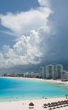 Storm clouds over a resort. Storm clouds cover towers of a resort near Punta Cancun Royalty Free Stock Photo