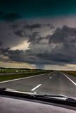 Storm clouds over the road. Stock Images