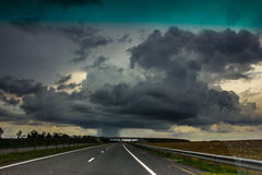 Storm clouds over the road. Royalty Free Stock Photo