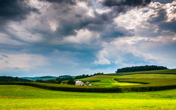 Storm clouds over rolling hills and farm fields in Southern York Stock Images
