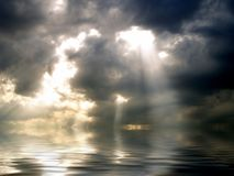 Storm clouds over the sea. Dark clouds and rays of light over the sea Stock Photography