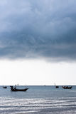 Storm clouds over sea. Storm clouds amassing over fishing boats on sea Stock Images