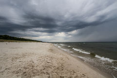 Storm clouds over the sea. Stormy weather at the seaside Royalty Free Stock Photo