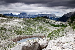 Storm clouds over Seven Triglav Lakes Valley, Julian Alps. Afternoon storm clouds arrive at Seven Triglav Lakes Valley, with  Zeleno Jezero lake, Prehodavci hut Stock Photos