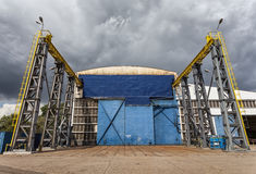 Storm clouds over the shipbuilding hall. Great gateway to the shipbuilding hall stock image
