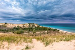 Storm Clouds Over Sleeping Bear Dunes and Lake Michigan, USA. Storm clouds move over Lake Michigan, towards Sleeping Bear Dunes National Lakeshore, near Glen Royalty Free Stock Photo