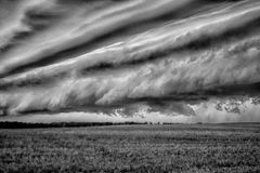 Storm clouds over the sloping field Royalty Free Stock Image