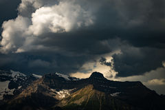 Storm clouds over snowy mountains in Banff National Park Royalty Free Stock Photos