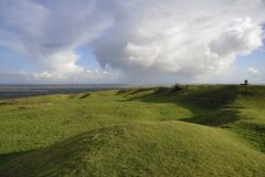 Brent Knoll Hill Fort. Storm Clouds over Somerset Levels Viewed from top of Brent Knoll Hill Fort with Glastonbury Tor in the distance Royalty Free Stock Images