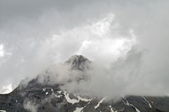Storm clouds over Swiss Alps Stock Photo
