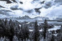 Storm clouds over the Teton Mountain  Range. And the Snake River Royalty Free Stock Photos