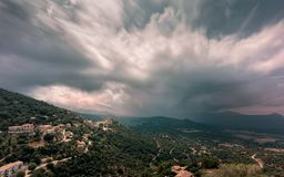 Storm Clouds Over The Mountain Village Of Belgodere In Corsica Royalty Free Stock Photos