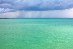 Storm clouds over the turquoise sea Royalty Free Stock Photography