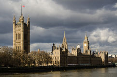 Storm Clouds over Westminster. Storm clouds floating ominously over the Palace of Westminster, home to the House of Commons and House of Lords, the UK's Stock Photo