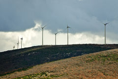 Storm clouds over wind turbines Stock Photo