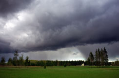 Storm Clouds and Park with Forest. Huge rainy cloud approaching. Dramatic sky Stock Photos