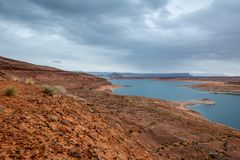 The Lake Powell National Recreation Area. Storm clouds pass over the Lake Powell National Recreation Area creating an ominous landscape scene stock image