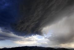 Storm Clouds Passing Over Mountain Range Royalty Free Stock Photography
