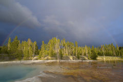 Storm clouds at Prismatic Springs in Yellowstone. Stock Photography