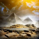Storm clouds and pyramids Stock Images