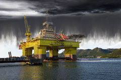 Storm clouds and rain. Oil Rig on sea and the impending collapse of the weather Stock Photos