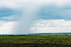 Storm clouds with rain over meadow Royalty Free Stock Photos