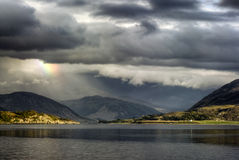 Storm clouds with rainbow, Loch Broom, Highlands, Ullapool. Highlands, Scotland Stock Photography
