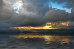 Storm clouds and rays of the sun through the clouds Stock Photos