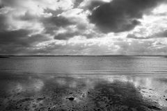 Storm clouds reflected in the sea Royalty Free Stock Photography