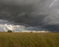 Storm clouds rolling over fields Royalty Free Stock Image