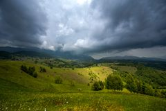 Storm clouds in the Romanian Carpathian mountain during summer time Royalty Free Stock Photo
