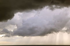 Storm clouds on the sea. Dark storm clouds on the sea Royalty Free Stock Photo