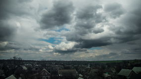 Storm Clouds in the Sky are Moving over the Houses of the City. Time Lapse stock footage