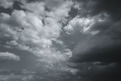 Storm clouds in the sky over the city. Gray gloomy sky before hurricane royalty free stock photo