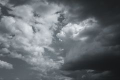 Storm clouds in the sky over the city. Gray gloomy sky before hurricane royalty free stock image