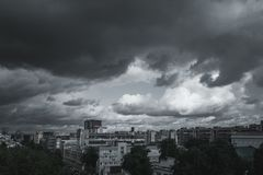 Storm clouds in the sky over the city. Gray gloomy sky before hurricane stock image