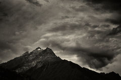 Storm clouds with snow mountain Royalty Free Stock Photos