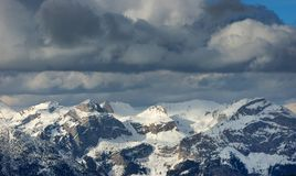 Storm Clouds With Snow Mountains Stock Photos