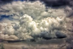 Storm clouds. On the spring blue sky Stock Images