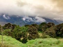 Storm clouds with sun over tungurahua volcano in Banos, Ecaudor Stock Photo