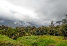Storm clouds with sun over tungurahua volcano in Banos, Ecaudor Stock Photos