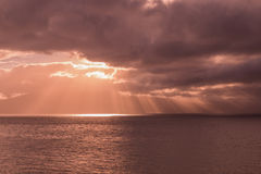 Storm Clouds and Sunbeam at Sunset Royalty Free Stock Image